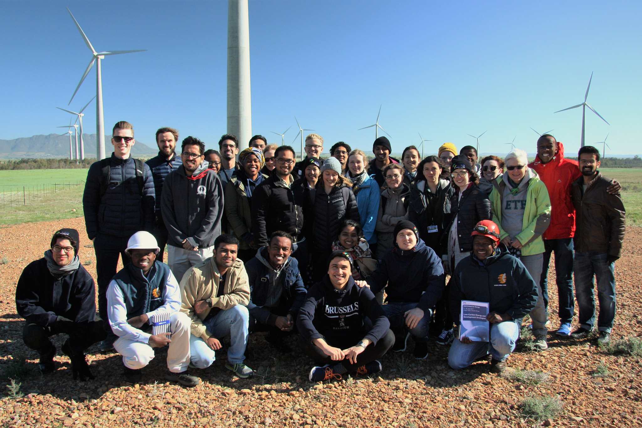 Group picture at the Gouda Wind Farm, one of the largest wind-farms in Southern Africa with 138 MW nameplate capacity. Photo credit: Energy Politics Group and ETH Global.