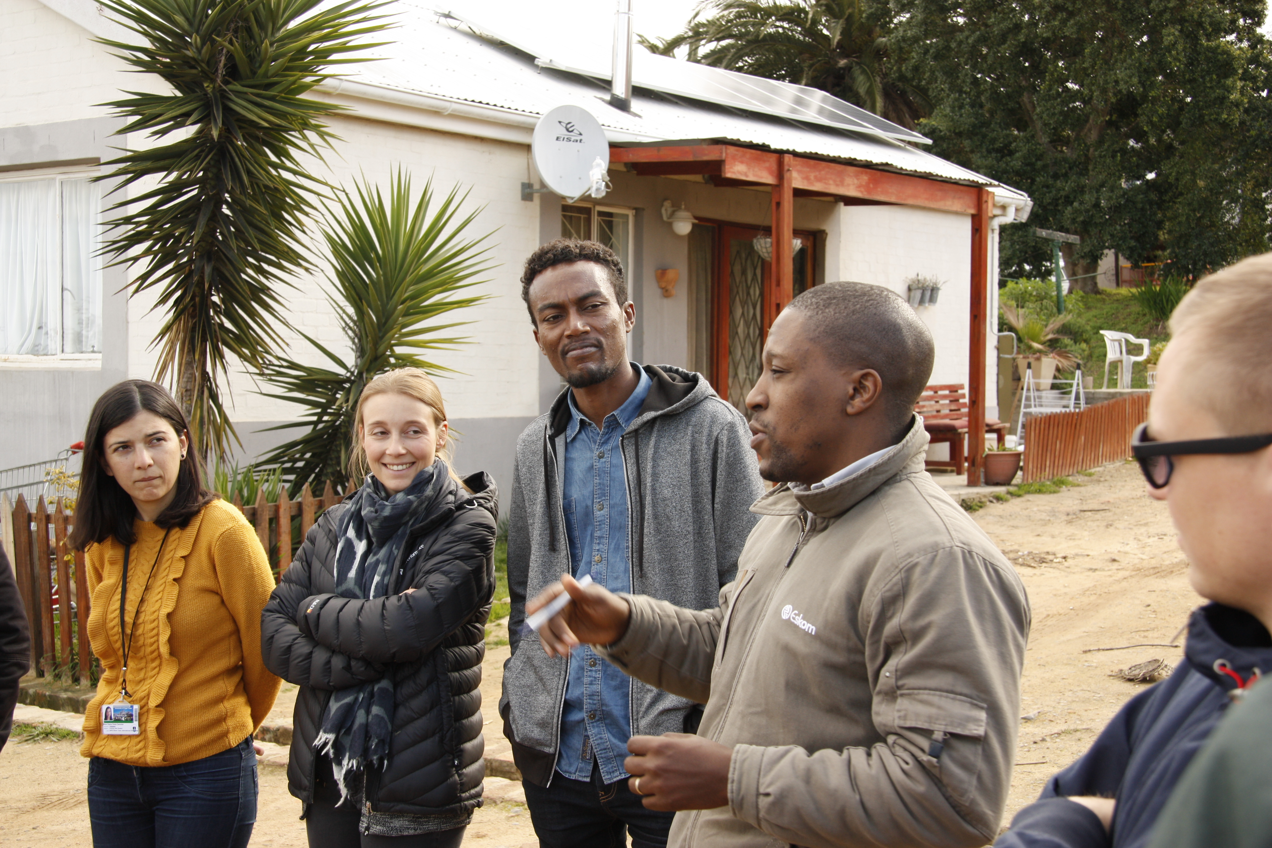 Excursion to the Lynedoch Eco Village outside of Stellenbosch. In the picture a empolyee from Eskom, the South African electricity public utility, explains about microgrids. Photo credit: Energy Politics Group and ETH Global.
