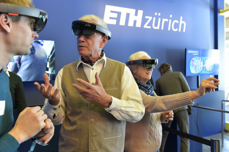 ETH Alumni engage with new HoloLens technology to study molecules for drug design.