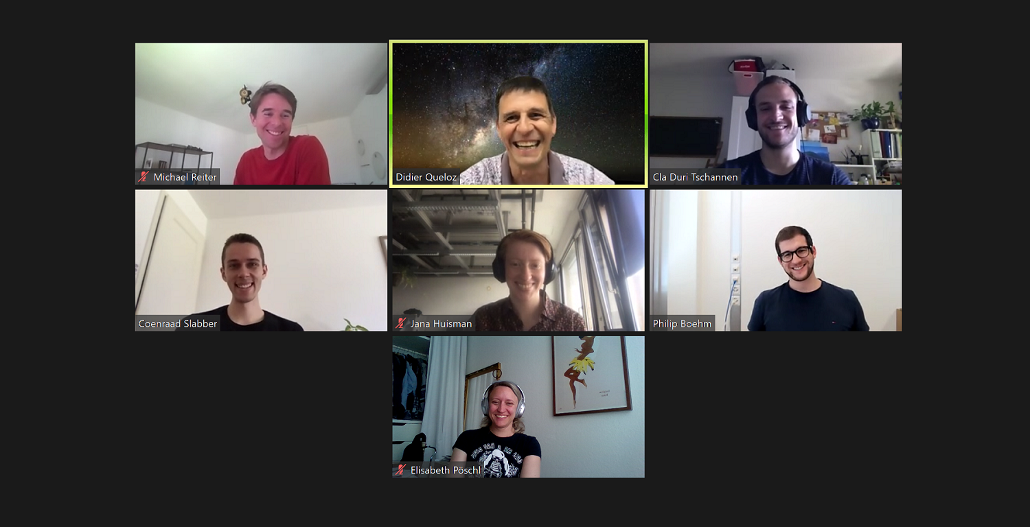 Zoom meeting of seven person, all are laughing
